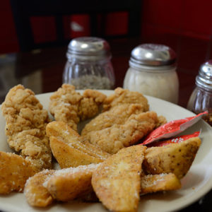 Delicious chicken tenders with fries