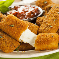 Deep-fried cheese sticks. Crispy on the outside, gooey on the inside. Served with a side of marinara sauce