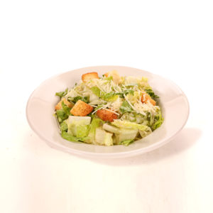 Romaine lettuce, croutons and parmesan cheese with side Caesar dressing
