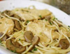 Roasted mushrooms in a rich Marsala cream sauce, served with malfadine pasta