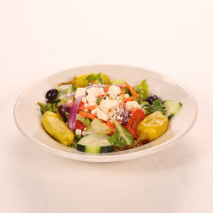 Feta cheese, tomatoes, cucumbers, onions, Kalamata olives, carrots, green peppers, and pepperoncini, over roman lettuce